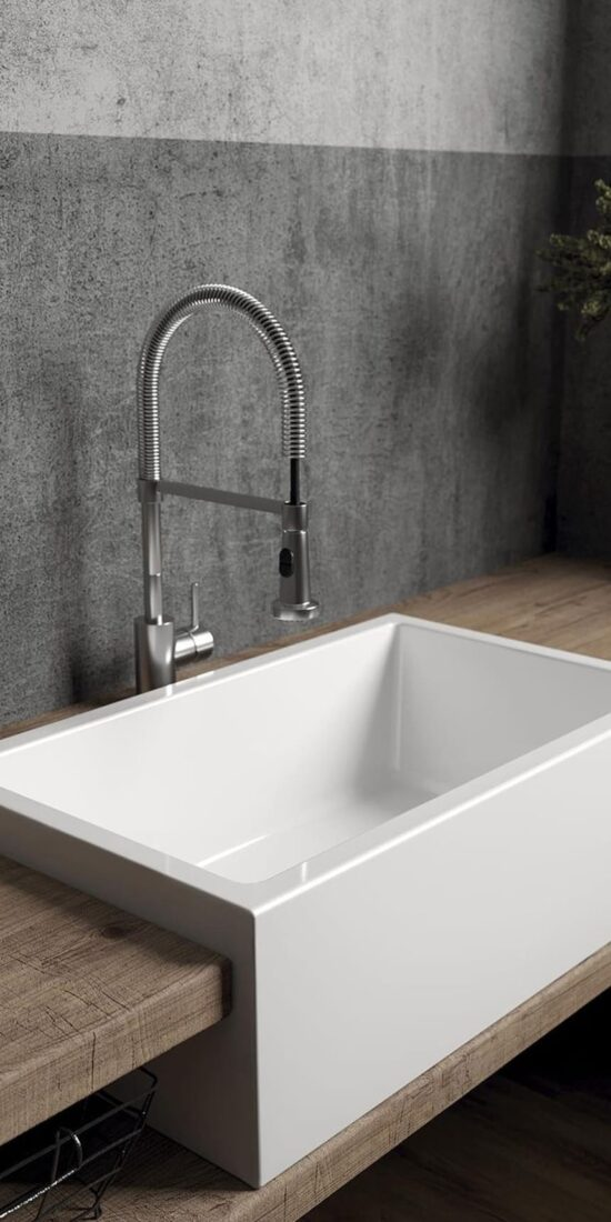 Reversible farmhouse sink made in solid casting.   Countertop apront-front sink with smooth side.